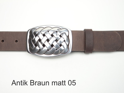 Leather belt with a silver-plated celtic design buckle