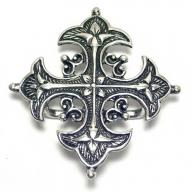 antique silver coloured buckle in historical cross form