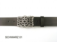 Belt with silver coloured intricately designed buckle