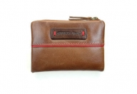 Small ladies wallet made of soft leather, color cognac
