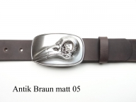 Leather belt featuring unusual birds skull buckle