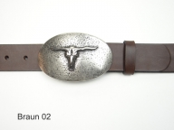 Leather belt featuring an oval buckle with a bulls skull design